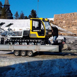 Our snow groomer transported on a car trailer