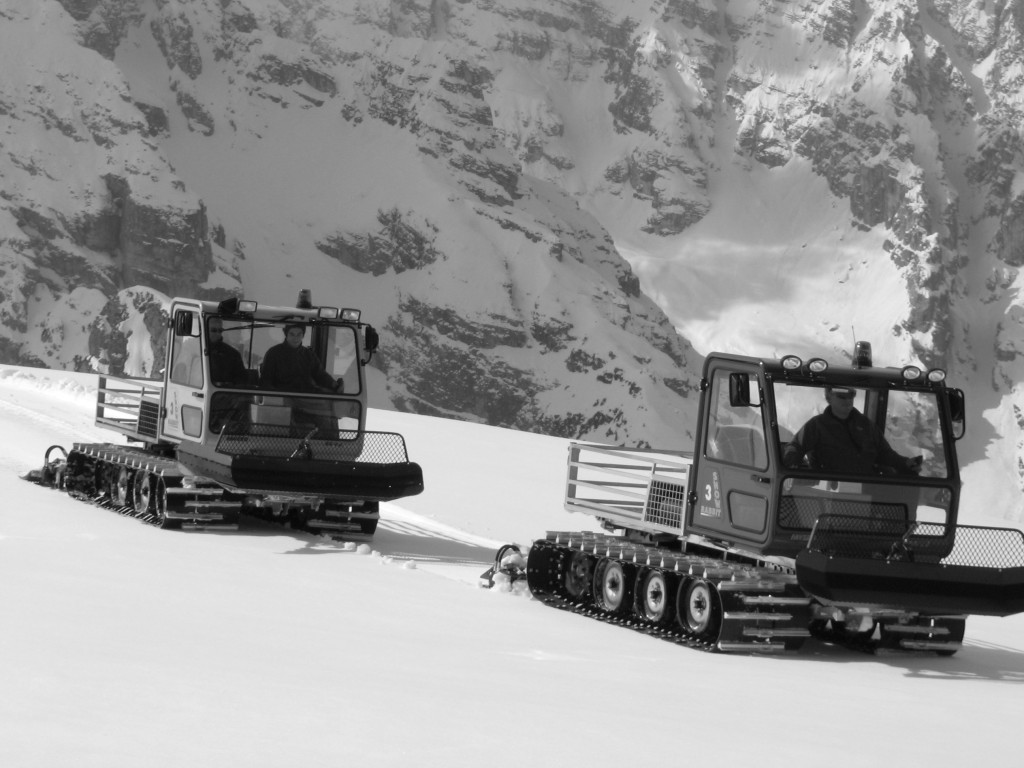 Two Snow Rabbit 3 plowing tracks in the Alps